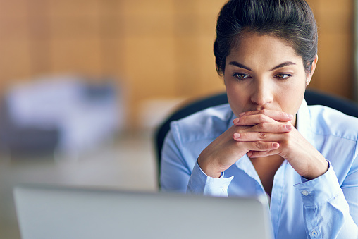Shot of a young businesswoman looking stressed while working on her laptophttp://195.154.178.81/DATA/i_collage/pi/shoots/806127.jpg
