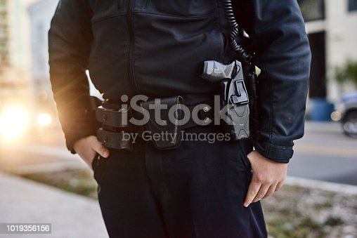 Closeup shot of an unrecognizable policeman out on patrol
