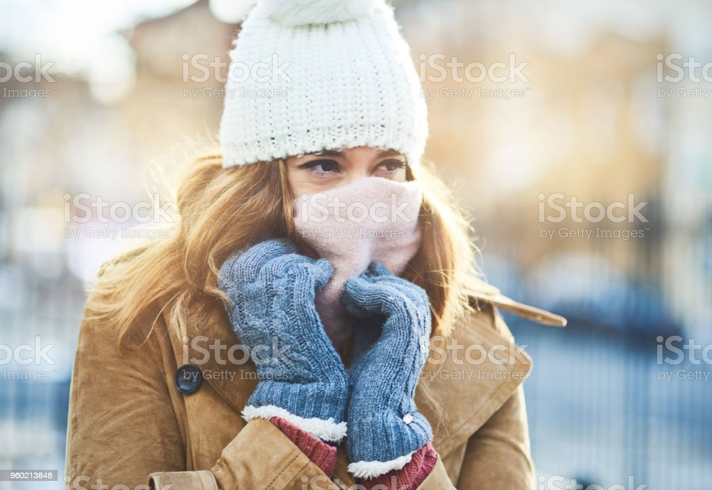 It's cold out here, I have to cover up stock photo