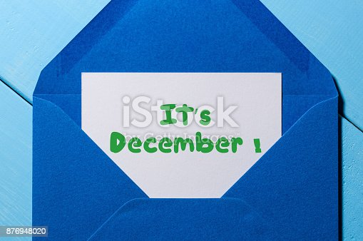 istock It's December - sign on paper at open blue post envelope. Winter, Eve and New year time concept 876948020