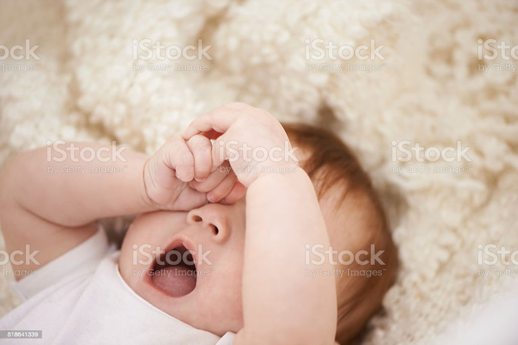 It's definitely nap time Shot of an adorable baby yawning 0-11 Months Stock Photo