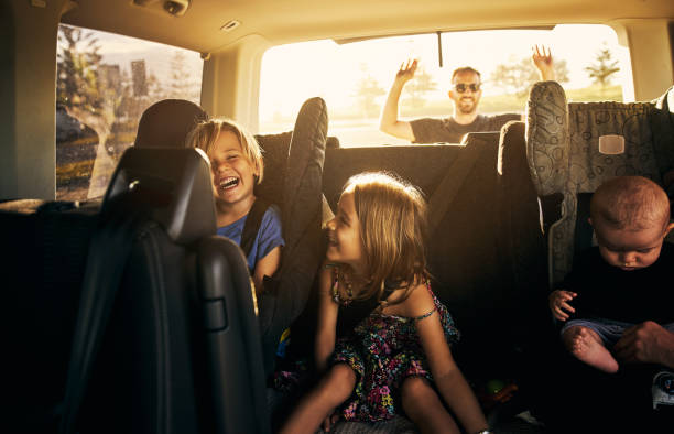 It's going to be fun fun fun! Shot of adorable little children sitting in a car road trip stock pictures, royalty-free photos & images