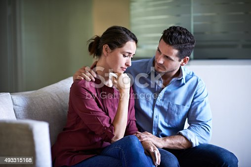 Shot of a husband comforting his wife in a hospital waiting room