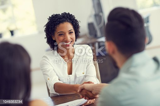 Cropped shot of a young therapist meeting a couple for a counselling session