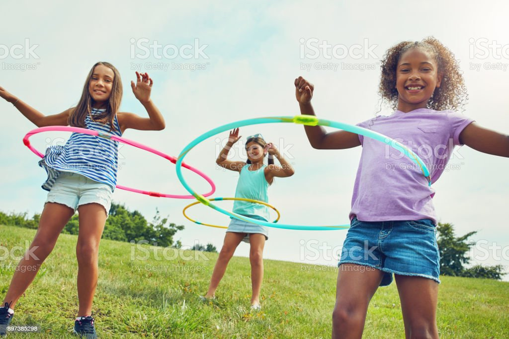 It's hard not to be happy when you're hula hooping stock photo