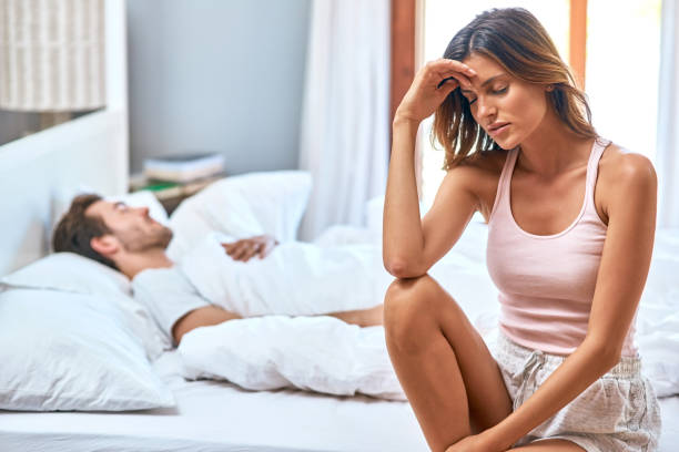 It's heartbreaking to have a troubled relationship Shot of a young couple having marital problems in the bedroom at home couple in bed stock pictures, royalty-free photos & images
