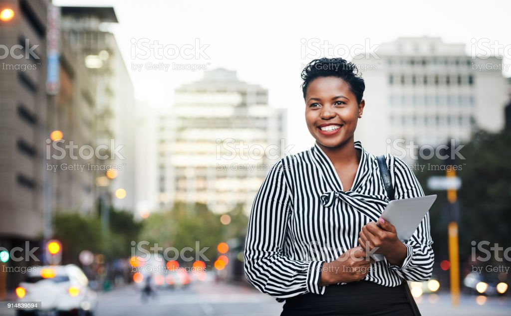 It's her favorite gadget for handling business on the go stock photo