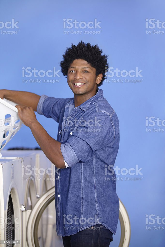 It's his turn to do the laundry stock photo