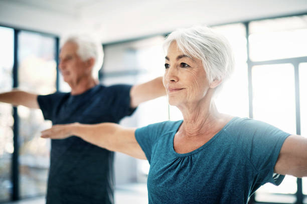 it's important to stay active as you age - relaxation exercise stock photos and pictures