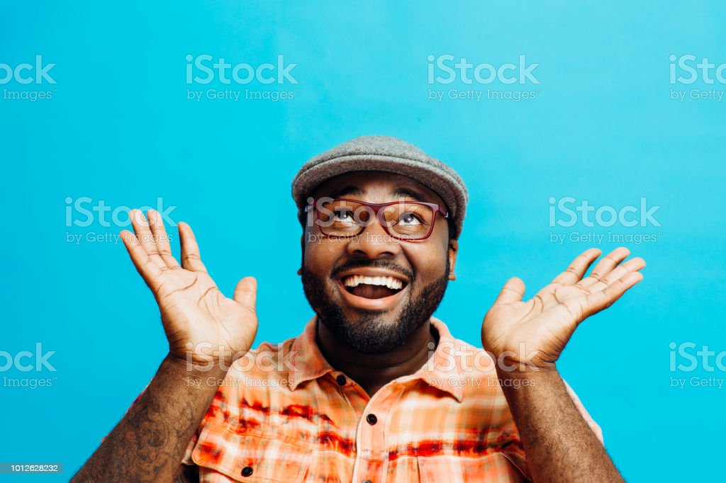 It's incredible! Portrait of a happy and excited man looking up royalty-free stock photo