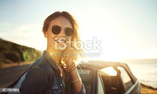 Portrait of an attractive young woman enjoying a roadtrip