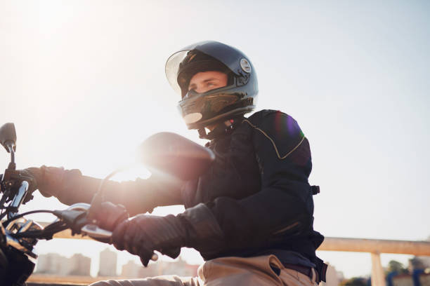 it's just you and the road - helmet motorbike imagens e fotografias de stock