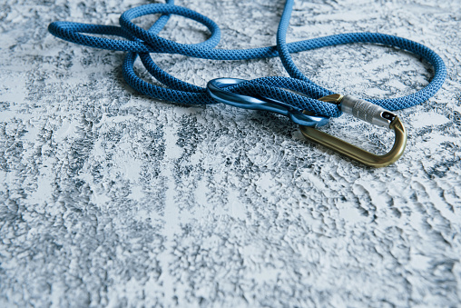 It's lifesavior. Knot with metal carabiner. Silver colored device for the active sports.