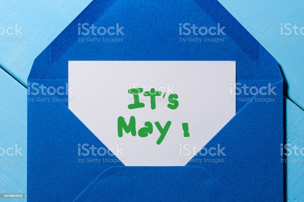 It's May - message at blue envelope. International Labor Day stock photo