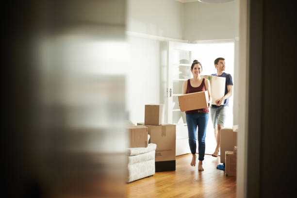 It's moving day Shot of a young couple carrying boxes into their new place house rental stock pictures, royalty-free photos & images