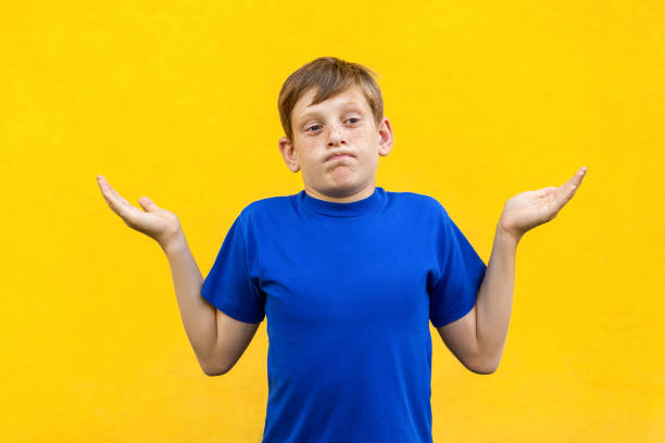 Boy Standing Stock Photos, Pictures & Royalty-Free Images