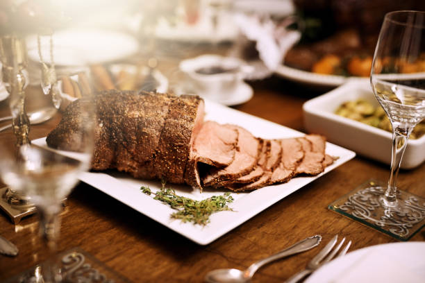 It's not a feast without roast beef Shot of a feast on a table at Christmas roast beef stock pictures, royalty-free photos & images