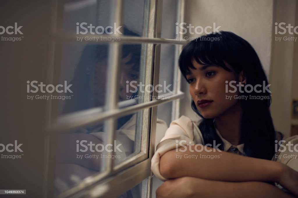 Its not easy going through this alone Cropped shot of a young attractive woman feeling depressed at home 20-29 Years Stock Photo
