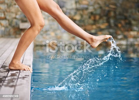 Cropped shot of a woman's foot in the swimming poolhttp://195.154.178.81/DATA/i_collage/pi/shoots/783411.jpg