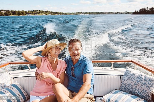 Shot of a mature couple enjoying a relaxing boat ride