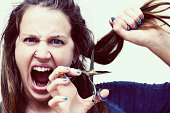 It's now or never! Young woman about to cut hair