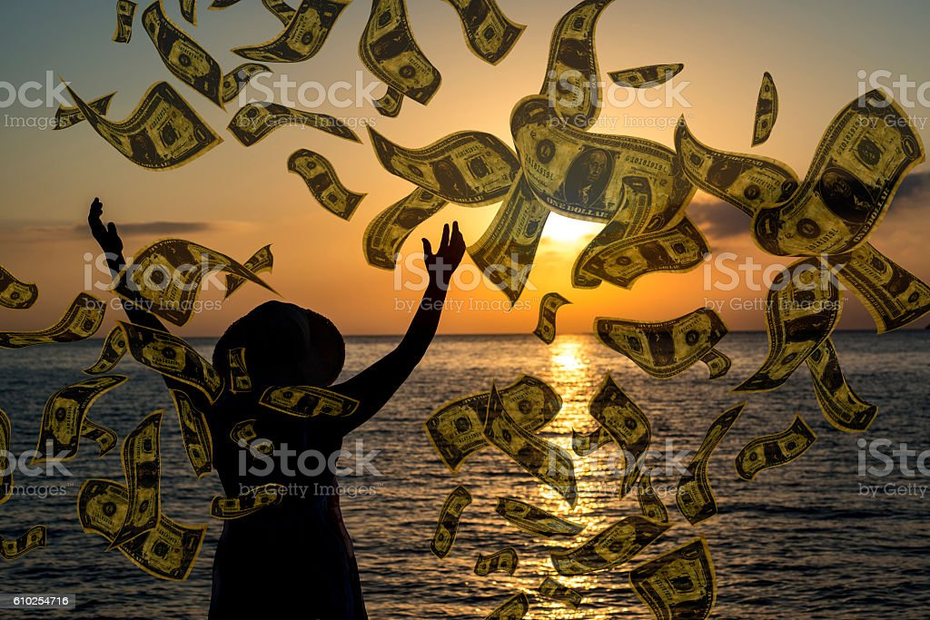 It's raining dollars woman on vacation stock photo