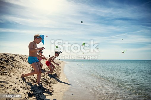 Summer Easter on beach. Kids are running and catching Easter eggs. Nikon D850
