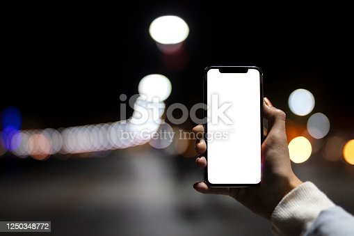 Shot of a hand holding a smartphone