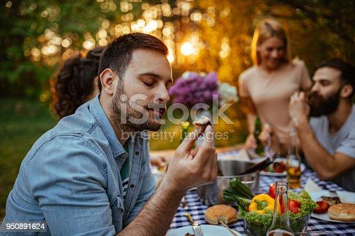 Young man enjoying a piece of food