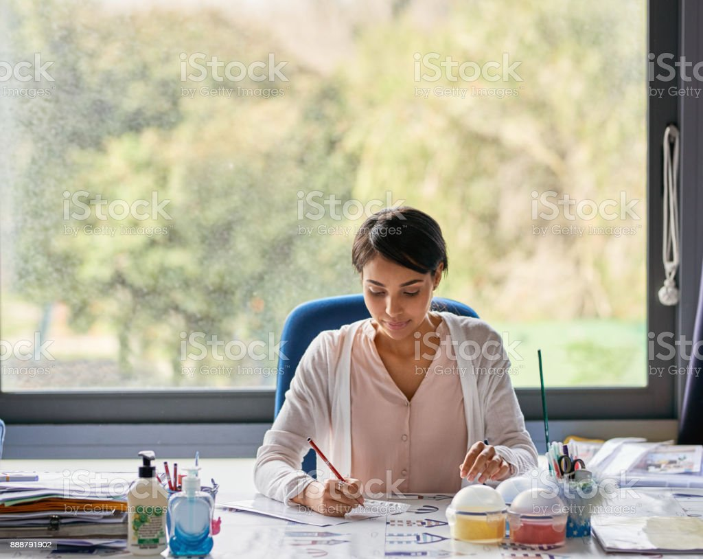 It's that time to grade all her students stock photo