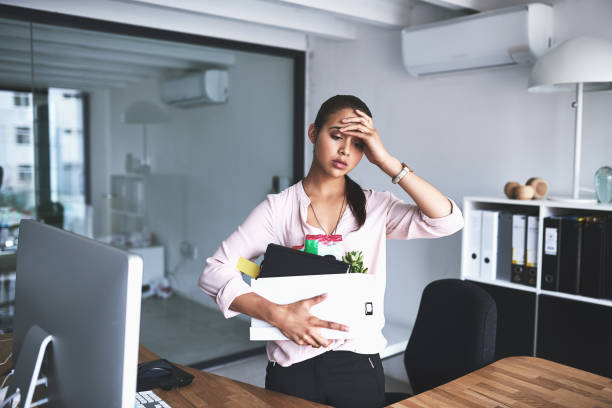 It's the most stressful thing that could happen to anyone Shot of an unhappy businesswoman holding her box of belongings after getting fired from her job rejection stock pictures, royalty-free photos & images