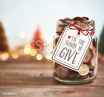 istock It's the season to give. Donation jar with money 1077890026