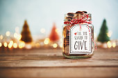 istock It's the season to give. Donation jar with money 1077890030