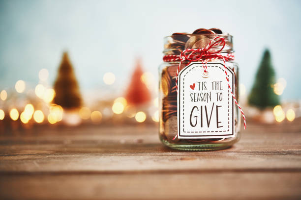 It's the season to give. Donation jar with money stock photo