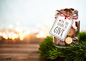 istock It's the season to give. Donation jar with money 1077890094