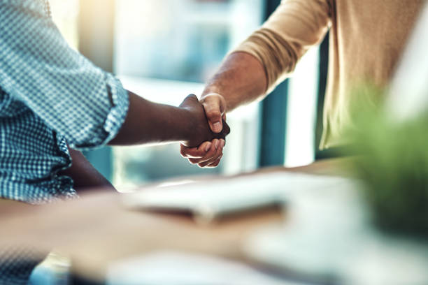 it's the start of amazing things - handshake stock photos and pictures