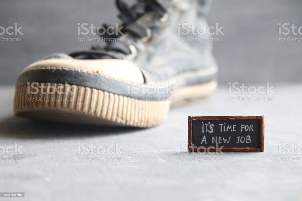 It's Time for a New Job tag and Sneakers stock photo