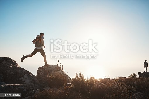 Shot of a mature man hiking up a mountain