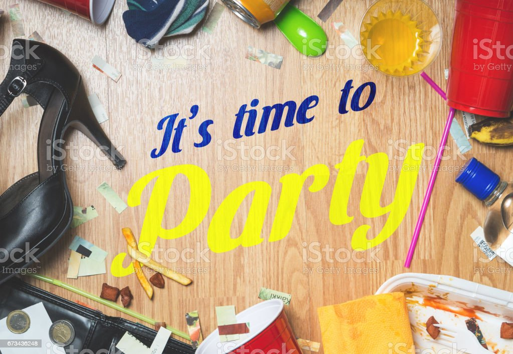 It's time to party text surrounded with drinks and trash from party last night. After party and hangover themed ad for marketing events. stock photo
