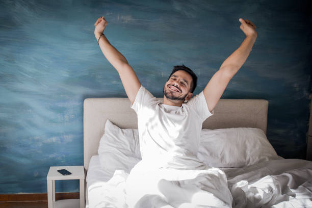 It's time to wake up the man is going to bed in the morning with a smile on his face sleeping stock pictures, royalty-free photos & images