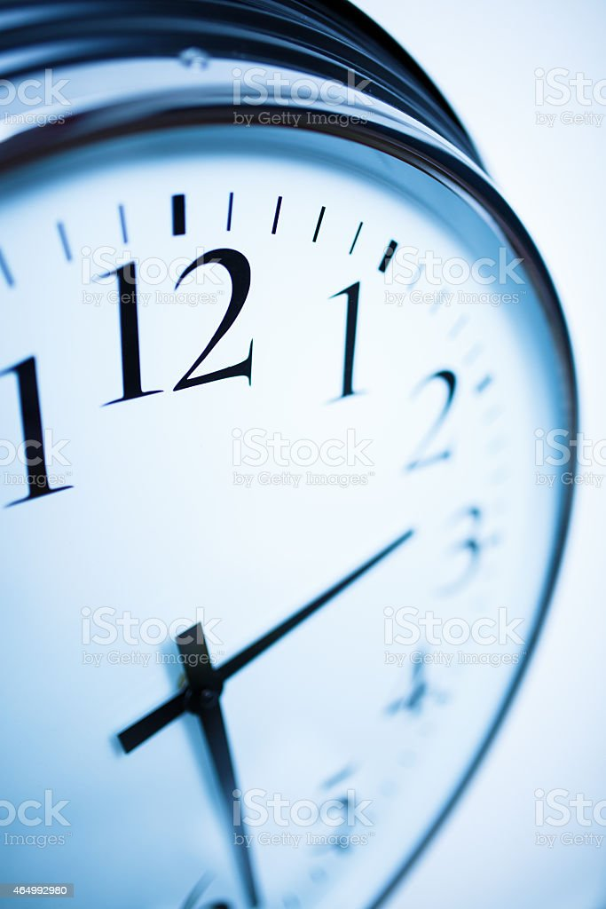 Its twenty four minutes past two Wall clock with blue tone. 2015 Stock Photo