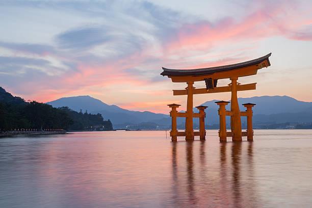 Itsukushima Shinto shrine on Miyajima in Japan Hatsukaichi, Japan - September 5, 2014: Itsukushima Shinto shrine, the famous Torii gate on Miyajima in Japan. shinto shrine stock pictures, royalty-free photos & images