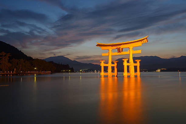 Itsukushima Shinto shrine on Miyajima in Japan Hatsukaichi, Japan - September 5, 2014: Itsukushima Shinto shrine, the famous Torii gate on Miyajima in Japan.  miyajima stock pictures, royalty-free photos & images