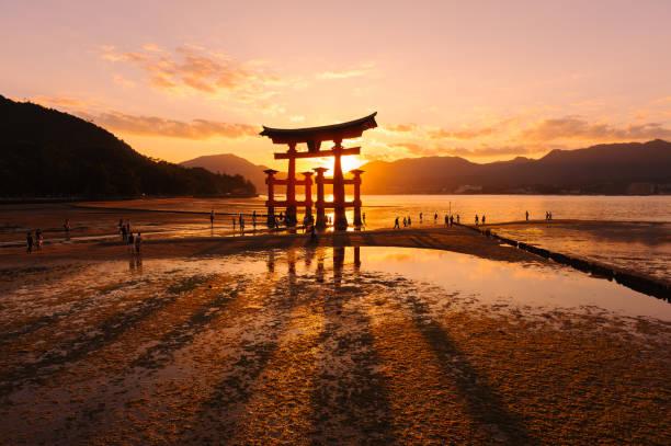 Itsukushima Shrine Photography of Torii & Sunset at Itsukushima Shrine miyajima stock pictures, royalty-free photos & images
