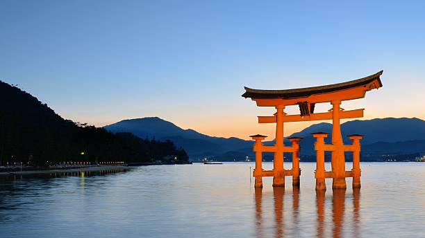 Itsukushima Torii Gate in Miyajima, Japan Miyajima, Japan - July 15, 2011: The famed Tori Gate at Itsukushima Shrine on Miyajima Island in Hiroshima Prefecture. The shrine was founded in the 6th Century and the current gate dates from 1875. torii gate stock pictures, royalty-free photos & images
