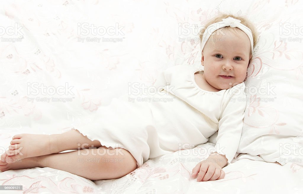 ittle girl, gathering to sleep on lacy bed royalty-free stock photo