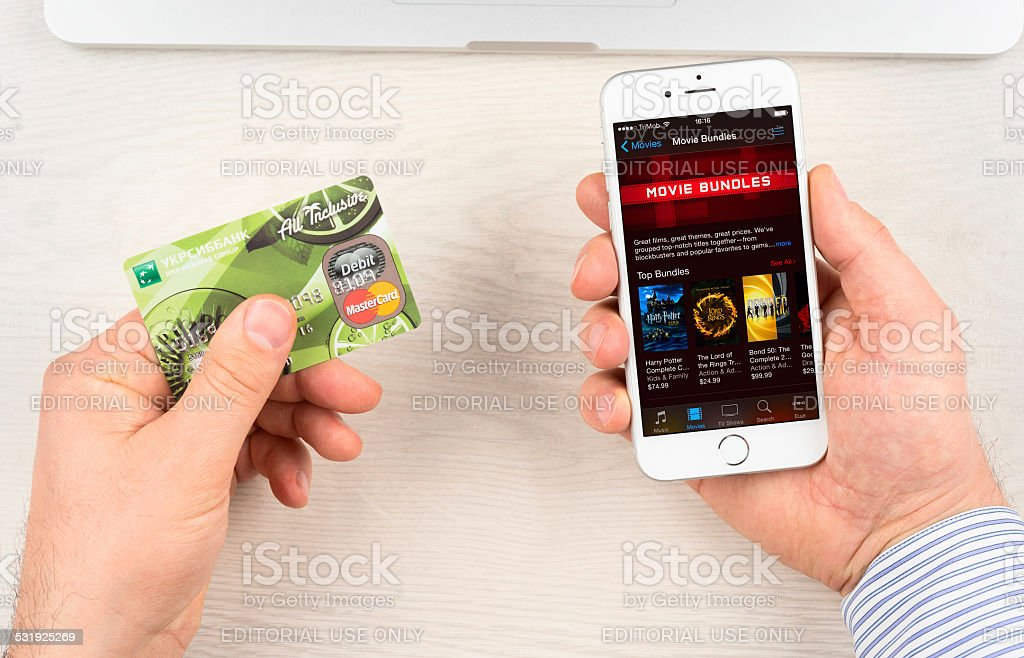 iTunes on Apple iPhone 6 device display stock photo