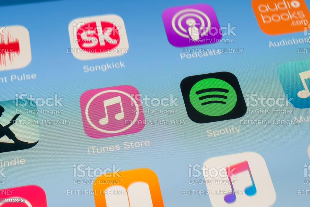 iTunes Store, Spotify and other music streaming Apps on iPad screen stock photo