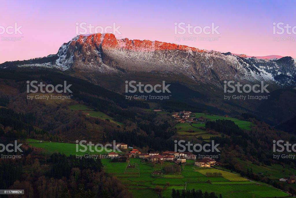 Itxina mountain with Zaloa and Urigoiti villages at sunset stock photo
