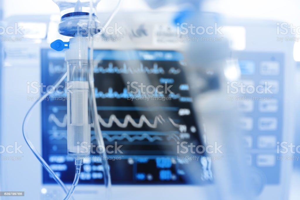 Iv drip on the background of monitoring ECG Iv drip on the background of monitoring ECG. Accidents and Disasters Stock Photo